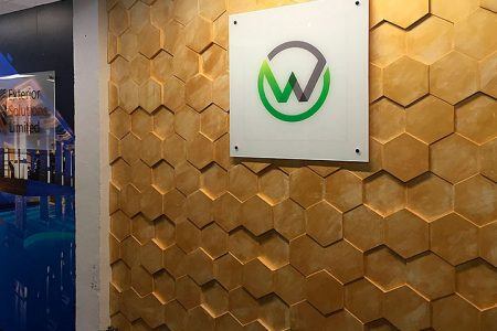 watermark kitchens showroom, concrete wall panels, hexagon panels, interior design showroom, stucco plaster, wooden wall panels,