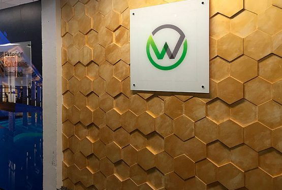 watermark kitchens showroom, concrete wall panels, hexagon panels, interior design showroom, stucco plaster, wooden wall panels,