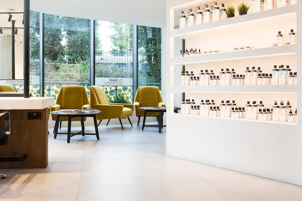 Industrial Retail Shelving made of white micro cement in Hair Movement Salon